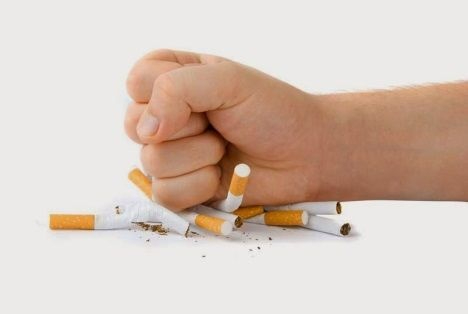 Photo of someone crushing cigarettes